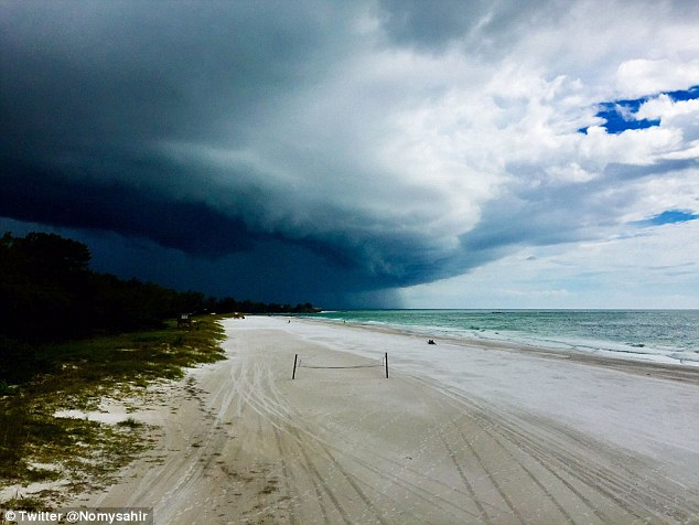 The intense storm rolled into Coquina Beach in Florida on Thursday afternoon, as the beach was nearly empty of people