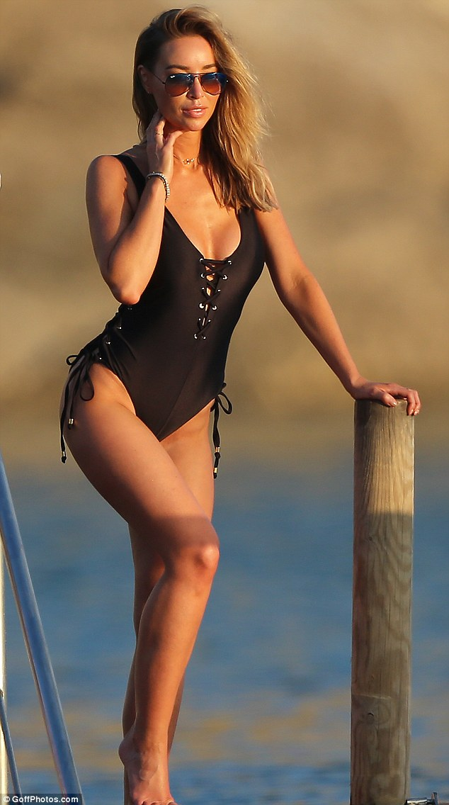 Stunning: Lauren Pope soaked up the rays in Ibiza as she flaunted her stunning figure in a racy lace-up swimsuit during a day at the beach