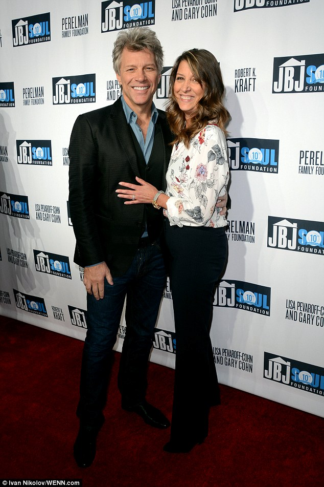 Loved up in NYC: on Bon Jovi held his wife Dorothea tight as they made a rare red carpet appearance together at his fundraiser on Thursday