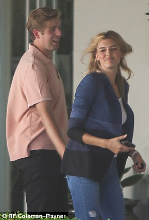Intimate: Kelly Rohrbach received a playful pat on her pert behind from a mystery man in Los Angeles Wednesday