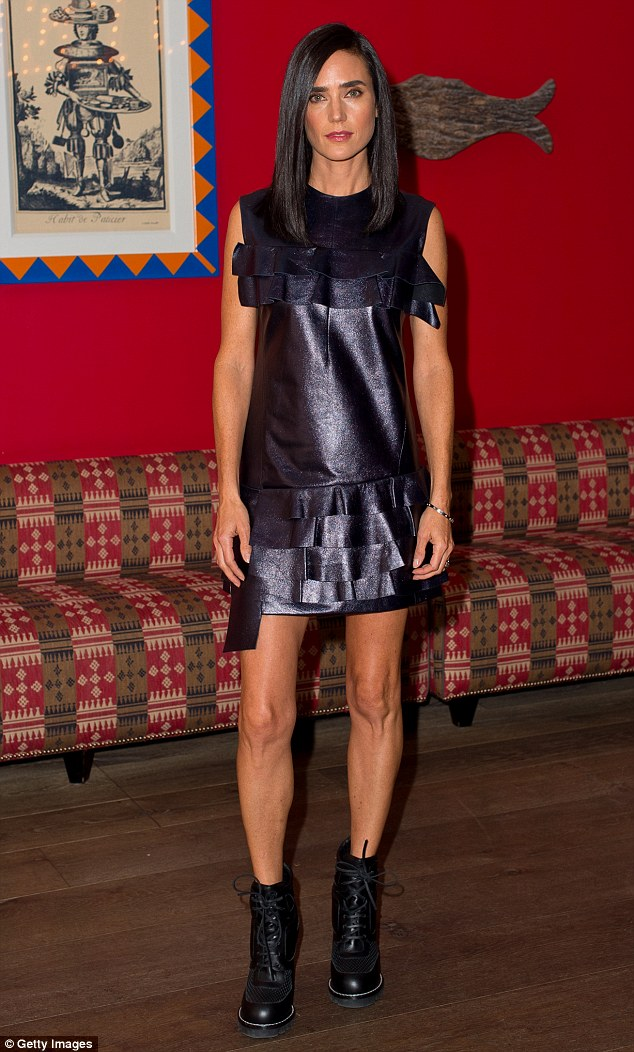 Daring to be different: Jennifer Connelly opted to emphasise her legs in a quirky leather dress with ruffle detailing