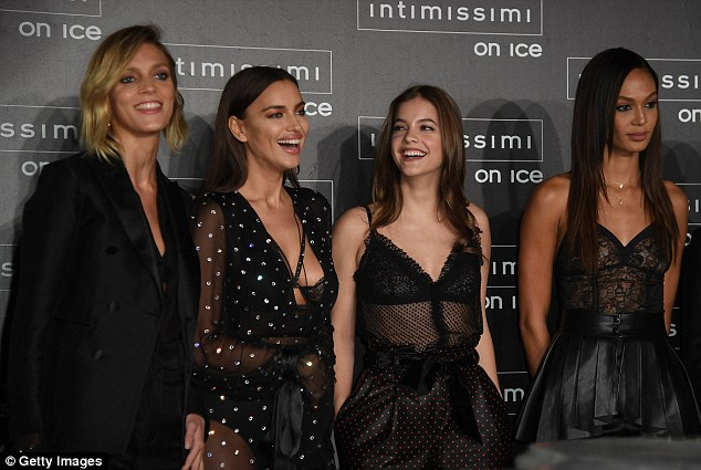 Model behaviour: She later posed beside the likes of fellow beauties Joan Smalls, Irina Shayk and Anya Rubik