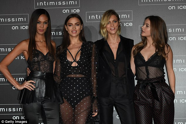 Lovely ladies: Barbara beamed as she posed beside her fellow models and friends