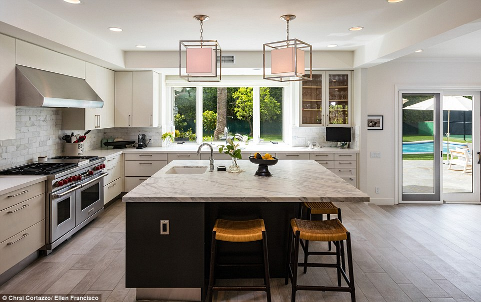 Another view to die for: Even the kitchen has windows that look out to the large swimming pool