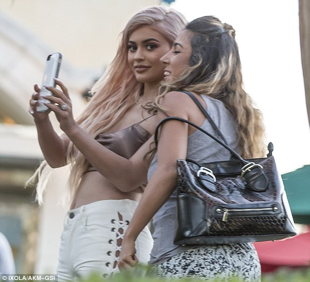Check me out: Kylie showed off her new rose gold hair colour and wore heavy make-up