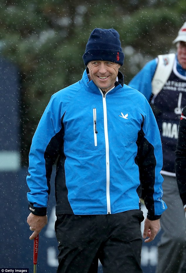 He's loving life! Hugh was all smiles - despite the rather drizzly weather in Scotland