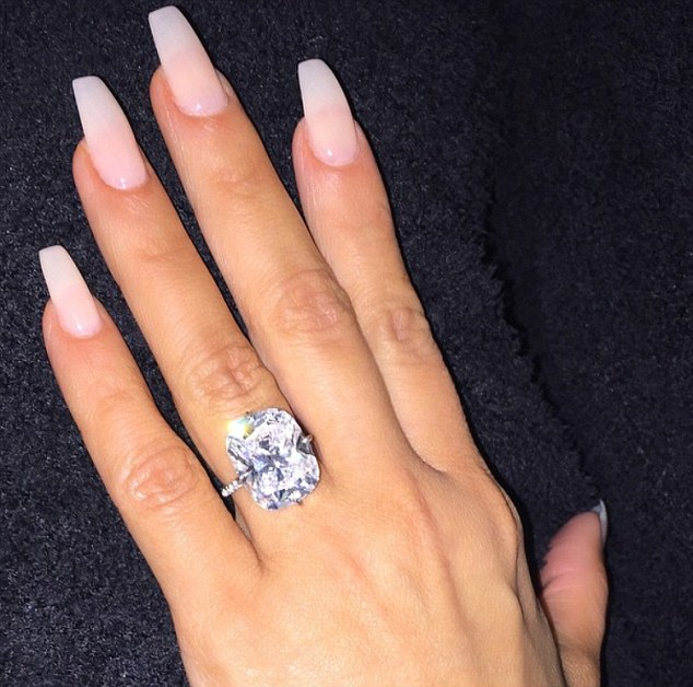 Her biographer Smith said: 'I don't think she needs to carry on as the Kim Kardashian we all know. She can now take a step back without the business suffering. Pictured: The £3.5million engagement ring thought to have been stolen in Monday's raid