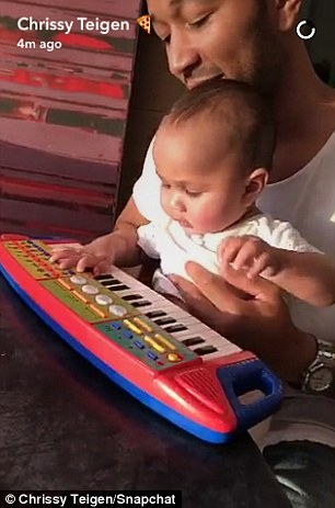 Learning piano!The married couple of three years - who plan on having three more children via IVF - left their six-month-old daughter Luna at home for their night out