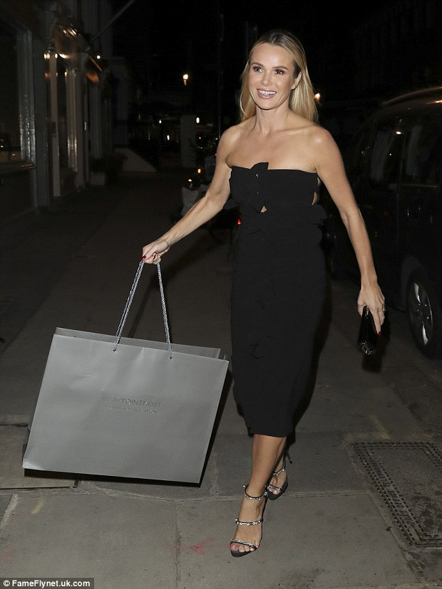 Back to black: Amanda Holden stuck to a simple black frock with silver strappy sandals