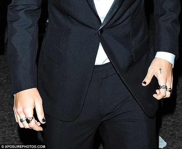 Interesting: Curiously, the Cheshire born star opted to wear jet black nail polish for his public appearance at the upmarket venue