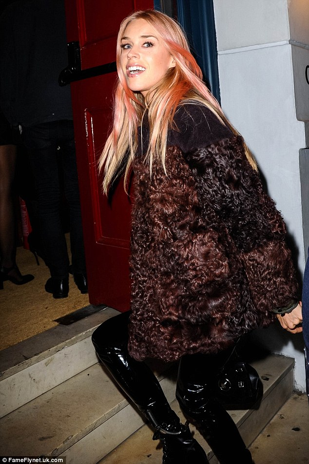 Dressed for success: Mary Charteris sported a furry coat and a pair of shiny leather boots