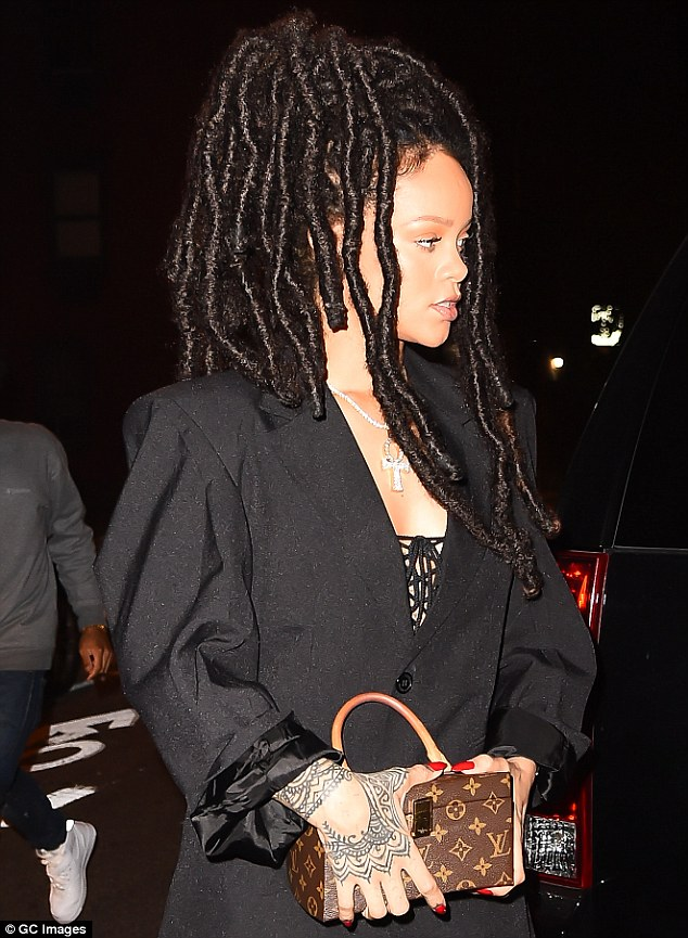 Lady in black: Rihanna opted for a nearly all-black ensemble as she stepped out