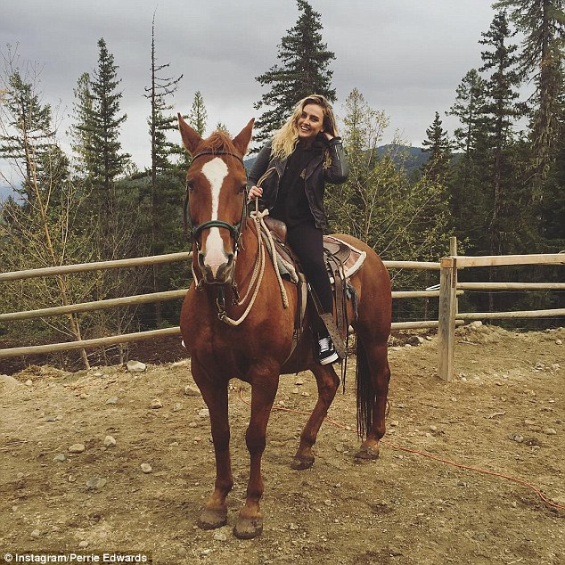 Giddy-up: The pop princess shared a snap of her riding a horse, as she beamed from ear to ear, clad in an all-black ensemble