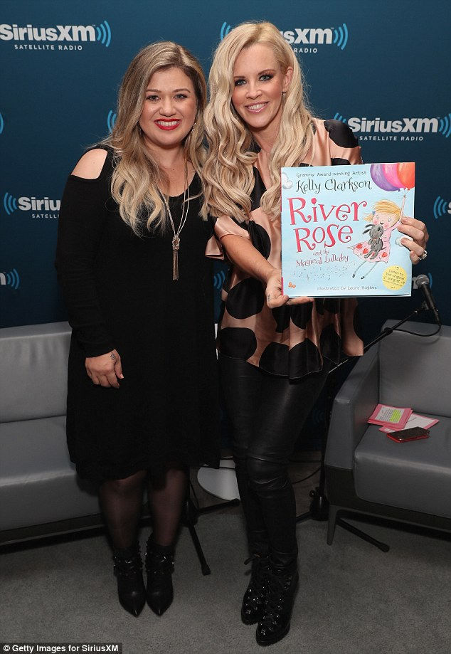 Aww: Kelly was on hand to promote her new children's book called River Rose and The Magical Lullaby as she posed with the 43-year-old radio show host