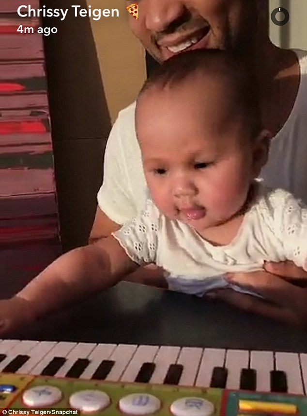 John Legend, 37, was quite the doting dad as he took time to teach daughter Luna Simone, five months, how to play the piano