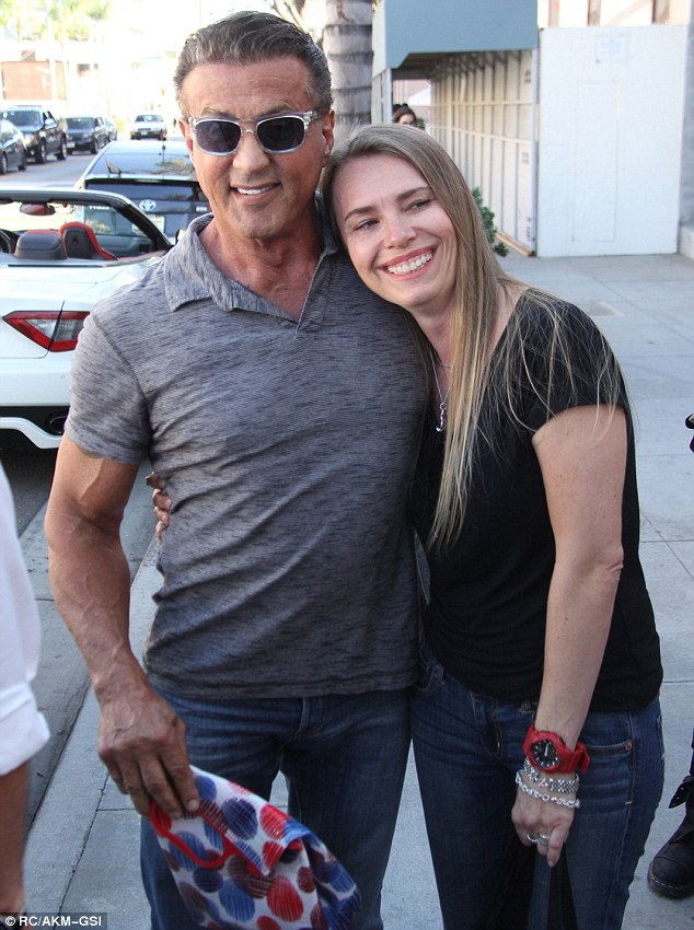 Fan favourite: Sylvester Stallone was approached by a superfan on Thursday in Beverly Hills, California