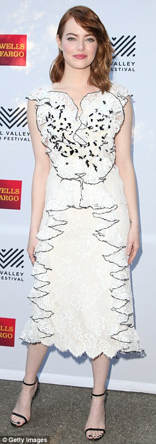 Positively angelic: The 27-year-old Easy A actress turned heads in an intricate white lace number that featured numerous frills and ruffles on the bodice