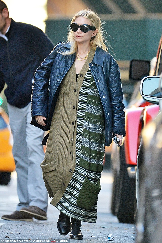 Knit wit: Cunning stylist Ashley Olsen donned an oversized cardigan in New York on Thursday