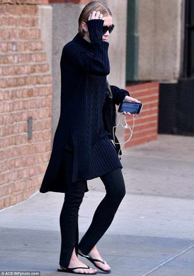 Knit again: She once again wore wool as part of her all-black ensemble