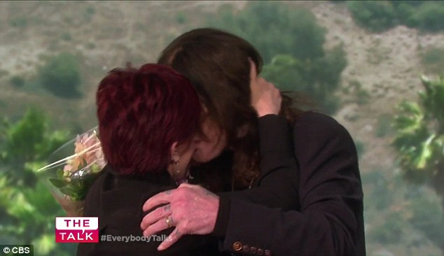 Hugs and kissed: The couple shared a tender moment with each other