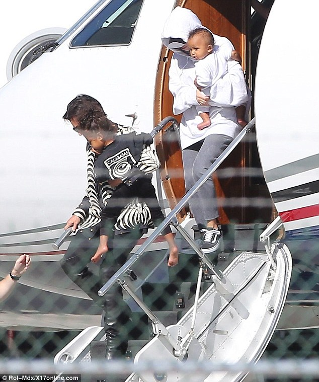 Touching down: The 35-year-old reality star touched down in Los Angeles with her two kids and mother Kris Jenner on Thursday