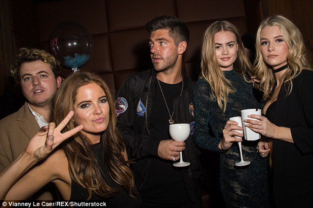 New friends? Lottie Moss (right) found herself partying with Made In Chelsea's Binky Felstead (second left) and Alex Mytton (centre) for a second night in a row on Thursday