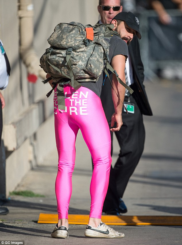 Tight and bright! The 30-year-old ran in a pair of hot pink tights which read 'Ellen for the cure' to raise funds for breast cancer research