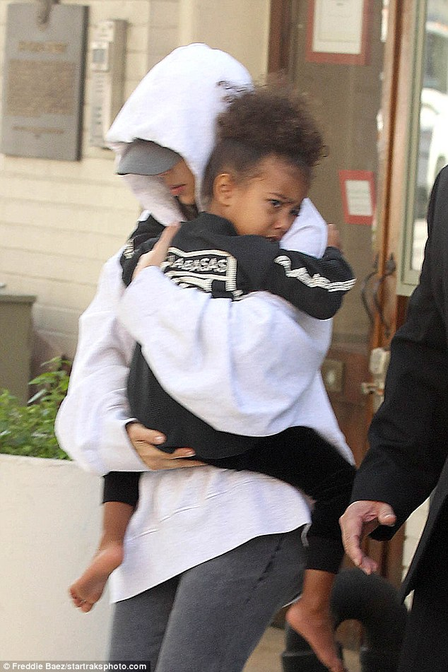 Recovering: As Khloe posted her video, a still traumatized Kim stepped out in New York with daughter North as well as husband Kanye West and son Saint (not pictured)