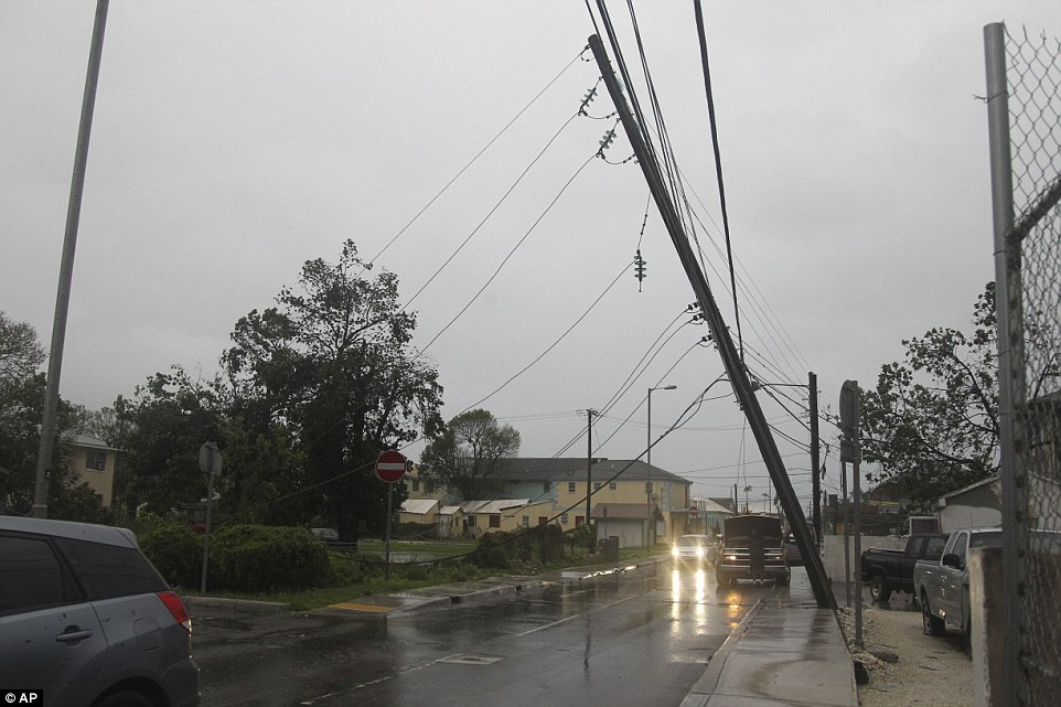 Electricity was shut off as a precaution ahead of the storm's arrival, and the nation's Prime Minister, Perry Christie, urged residents to prepare for a 'worst case scenario'. Pictured is a power pole that was almost topped in the wind