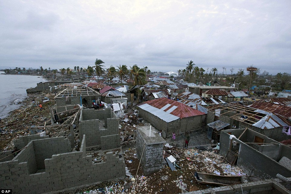 Destroyed: Homes lay in ruins after the passing of Hurricane Matthew in Les Cayes, Haiti, on Thursday