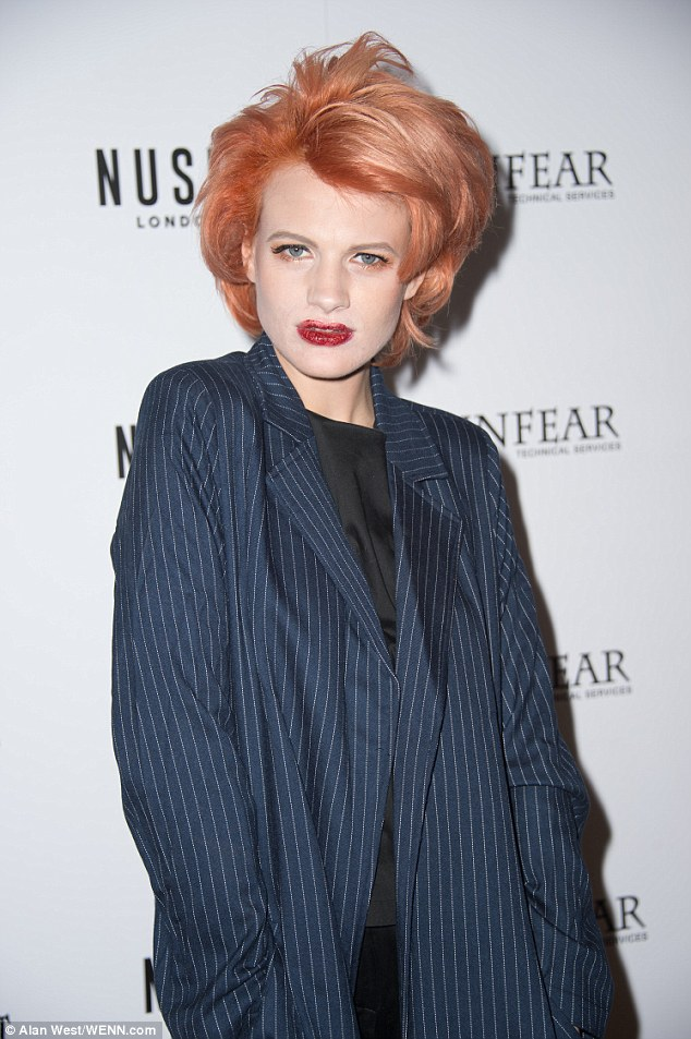 Making a statement: Eccentric Chloe sported a short and wild copper-coloured 'do with a dusting of orange around her piercing blue peepers and glistening red on her lips