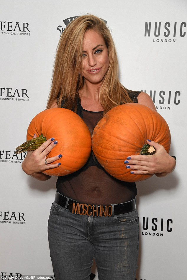 Nice pumpkins! She clutched two of the large fruits to her chest