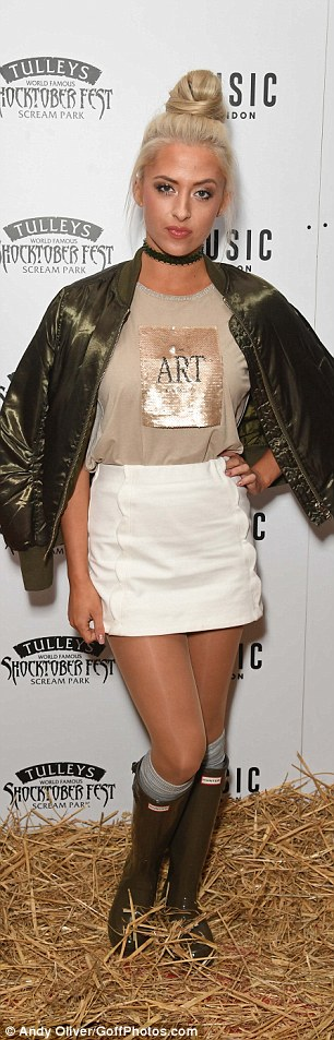 Mix and match: Chloe Paige went for farmyard glam, mixing a satin bomber with a white miniskirt and wellies