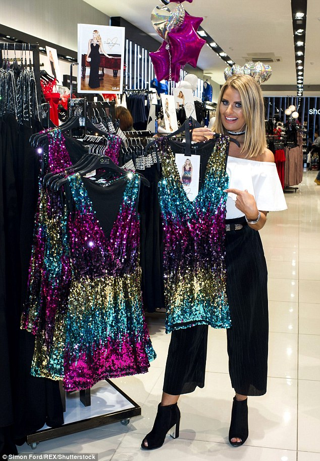 An eye for fashion: Danielle proudly displayed items from her range which included a glitzy multi-coloured dress