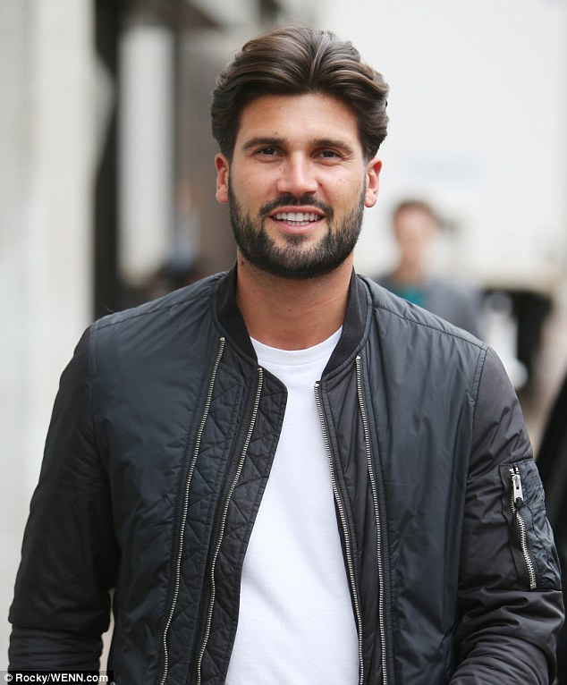 Well-groomed: The hunk wore his dark locks perfectly coiffed and his beard neatly groomed