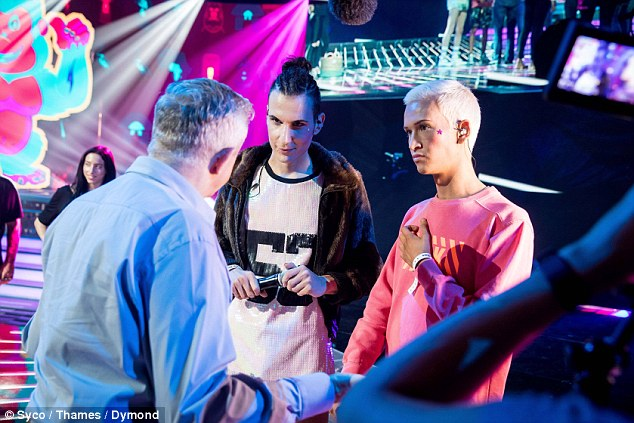 Guys, this is serious! Adding a splash of colour to the stage, the pair were reigned in by Louis, who was spotted giving them a serious talk and a stern word of advice