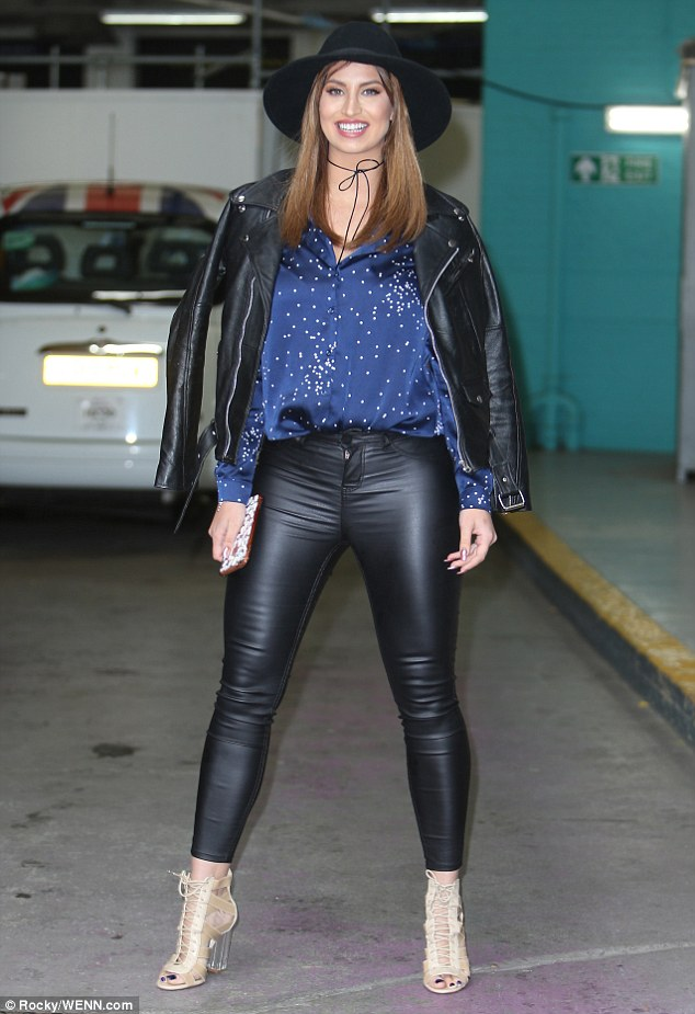 Work it! Ferne McCann has displayed her =hourglass figure in a pair of skintight leather trousers at ITV studios in London on Friday