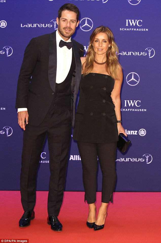 Harsh: Jack Whitehall has been teasing Jamie Redknapp about the infamous Strictly Come Dancing curse, suggesting his wife Louise (pictured together in April this year) might leave him for a professional dancer