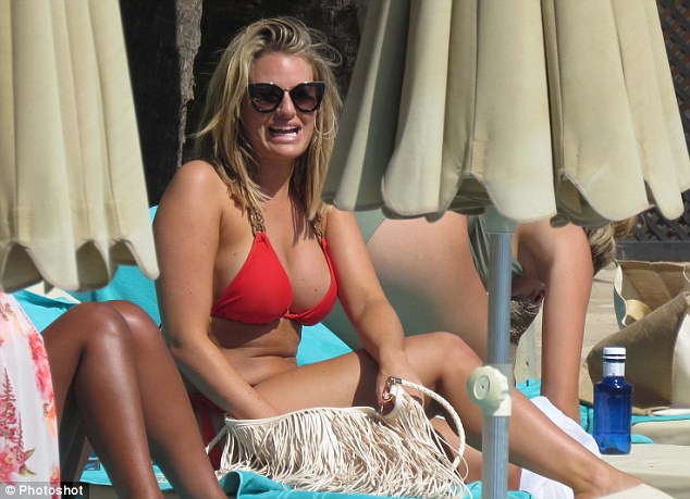 Girly day: Danielle  chatted and laughed with her gal pals from the comfort of her sunbed