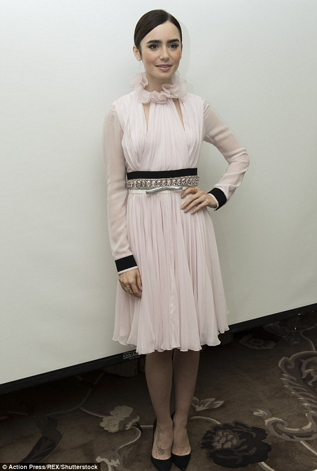 Effortlessly elegance: The actress, 27, looked effortlessly elegant as she slipped into a pretty pale pink midi-dress with a frilled high neck and long sleeves