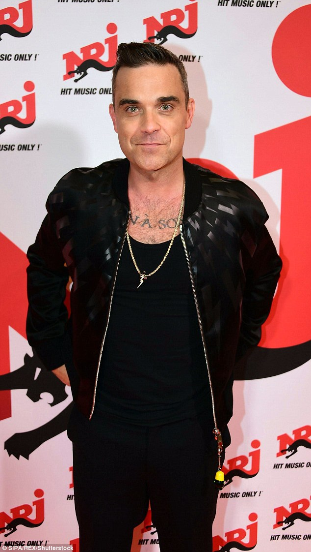 Staying strong: Former drug addict Robbie Williams has admitted he still fights urges to take certain substances