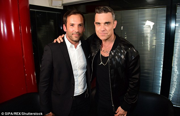 On the prom trail: Robbie dropped by French radio station NRJ in Paris on Thursday