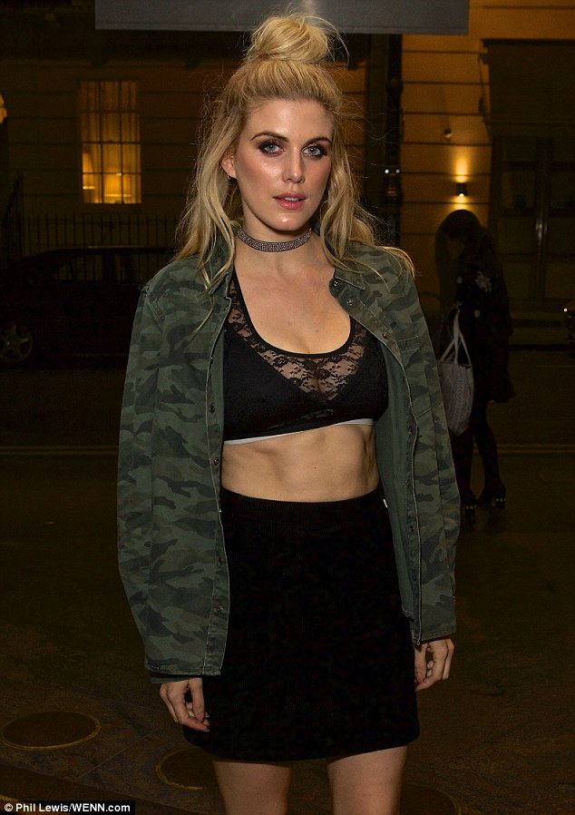 Abs-olutely gorgeous: Former Made in Chelsea star Ashley, 29, arrived at the bash first, turning heads immediately with her unbelievably defined abs