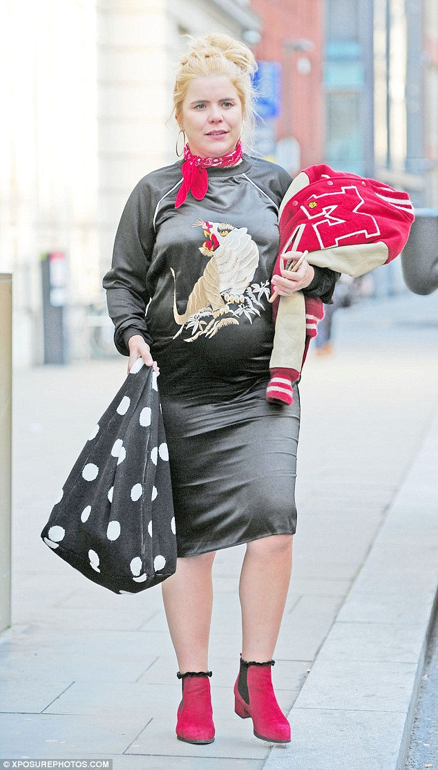 On its way!Paloma Faith appears to be delighting in her pregnancy as she was seen enjoying a jaunt around London's Soho with a pal on Wednesday