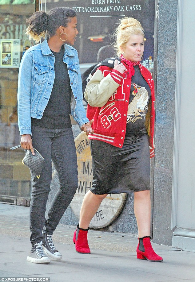 Fun loving:The 35-year-old songstress opted for a typically kooky ensemble comprising of a varsity jacket and embroidered dress, showing she will not let her changing shape stand in the way of her kooky style