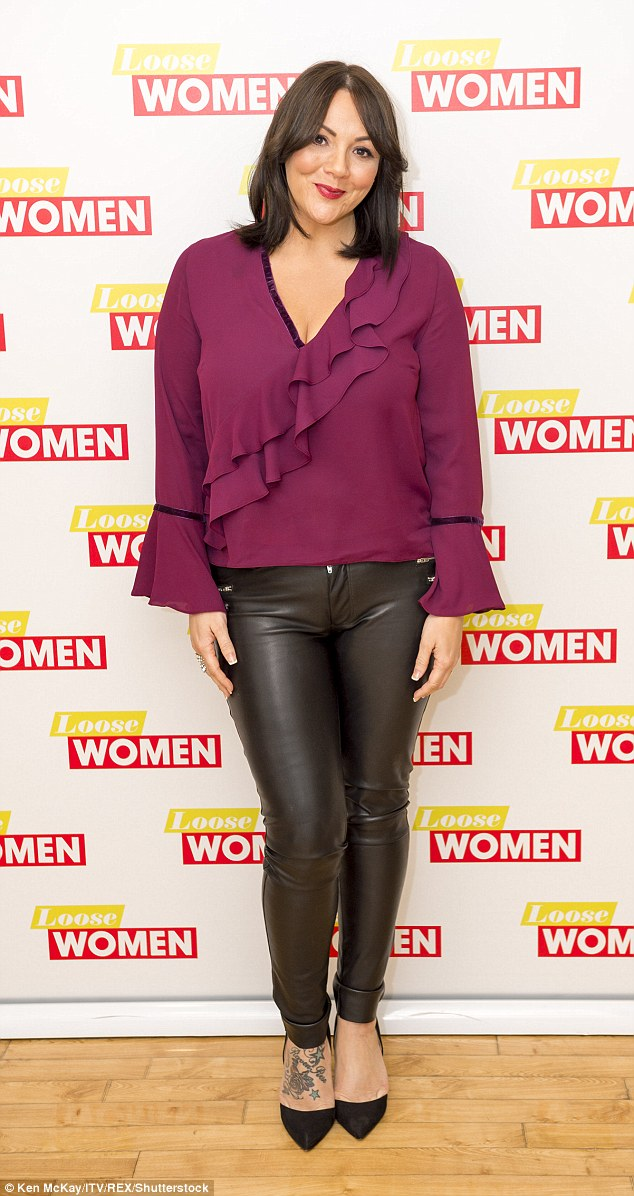 Stunner: Martine looked incredible in a maroon frilly top worn with leather trousers and heels - she flashed a foot inking as she posed for snaps backstage