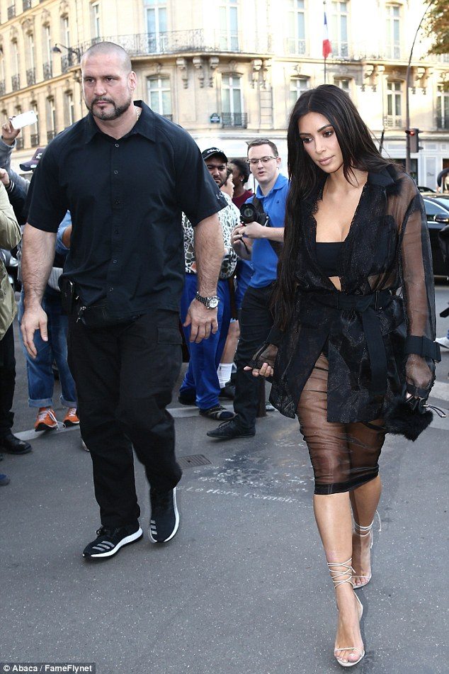 Vulnerable: Kim's bodyguard Pascal Duvier (left) was not by her side when she was robbed at gunpoint