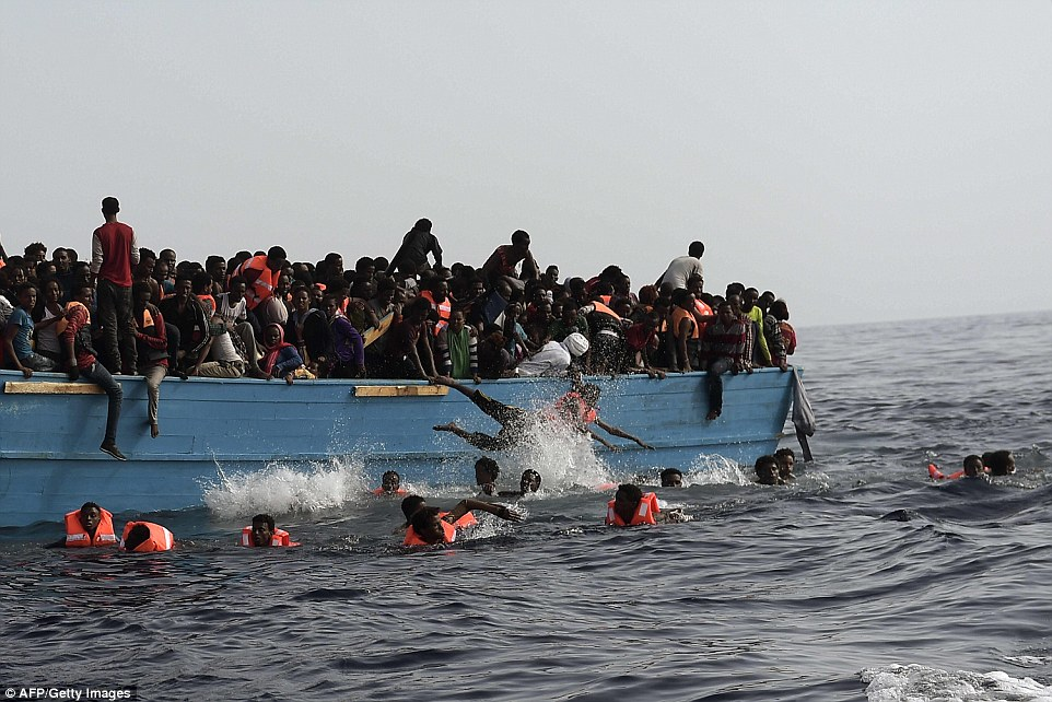 Awful scenes: Cruel smugglers jammed about 1,000 people on three levels inside the wooden boat and the catastrophic overcrowding caused deaths