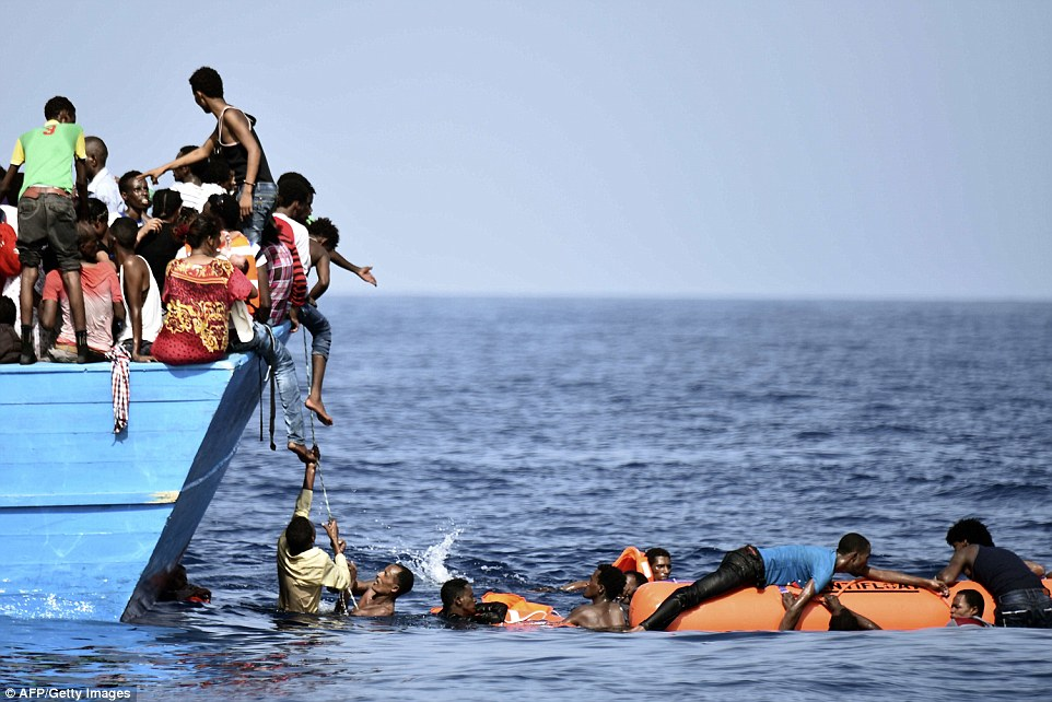 Waiting for help: The latest people to be rescued will add to a total of some 132,000 migrants who have landed at Italy's southern ports so far this year