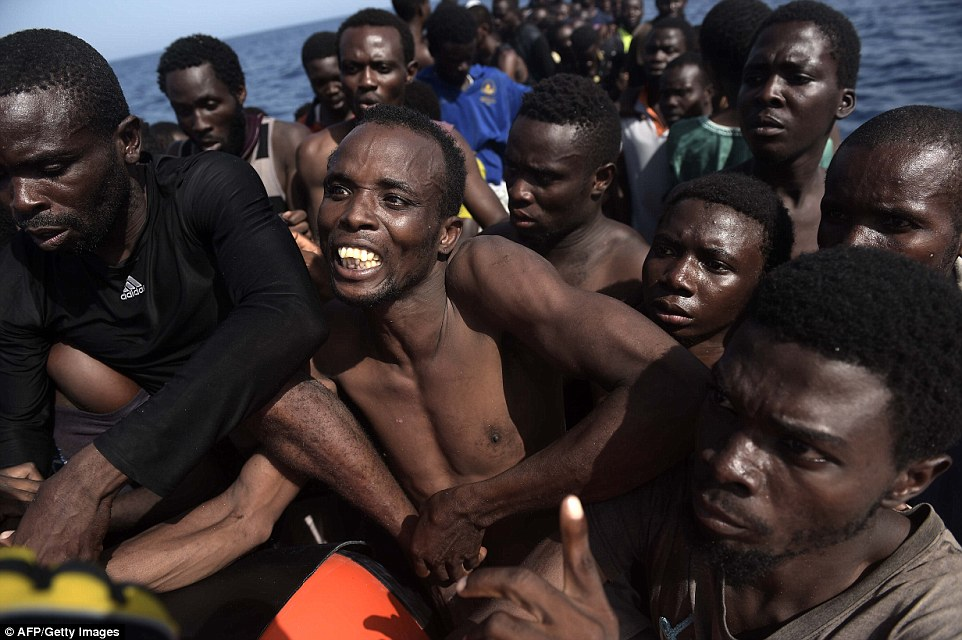 In need: Men struggle for life jackets as panic breaks out onboard, with people jumping into the water